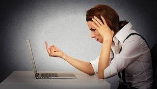 Woman-angry-facebook Shutterstock